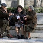 Elderly chatting on a bench in the street