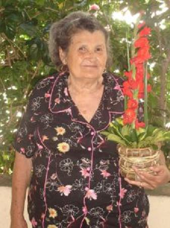 Grandmother with a plant in her hands