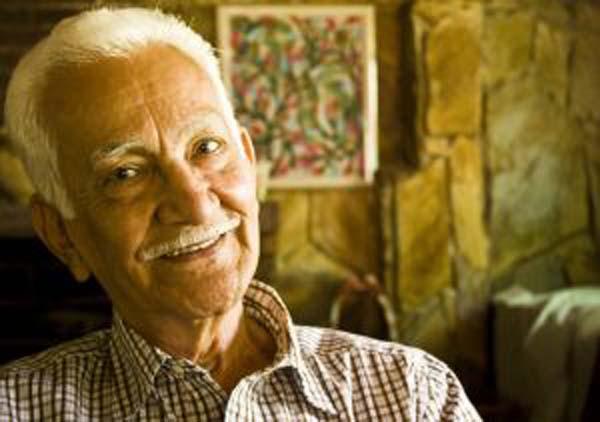 Happy elderly man in his home