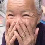 Happy embarrassed elderly woman