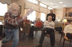 Seniors playing nintendo wii bowling
