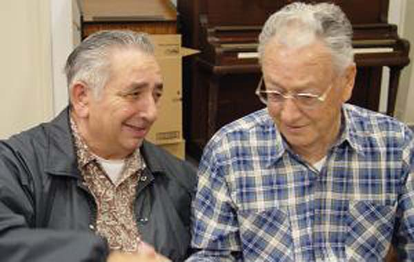 Two elderly men having a dinner together