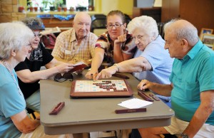 Indoor-Group-Activities-for-Seniors-Promote-Socialization.-Seniors-playing-scrabble