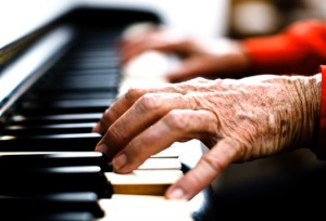 Name-that-Music-Indoor-Activity-for-Seniors-Senior-playing-piano