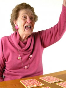 Simple-and-Fun-Indoor-Activities-for-Seniors-woman-playing-bingo