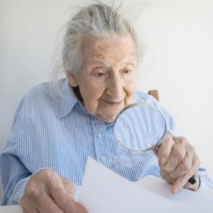 Choosing the Right Adaptive Brain Games for Seniors Senior Woman playing brain puzzle.jpg